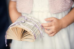 Little girl with wedding rings in her hands Stock Photos