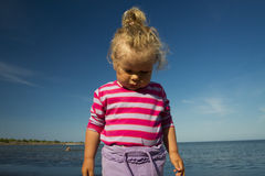 Little girl weeping by the sea. Royalty Free Stock Image
