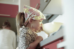 Little girl weighing flour for a birthday cake Stock Image