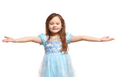 Little girl welcome gesture. Little girl spreading her hands in a welcome gesture Stock Photography
