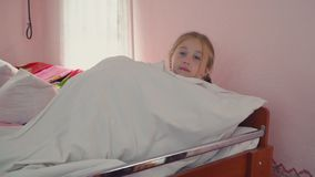 The girl went to bed. The little girl went to bed stock footage