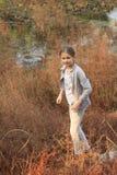 Little girl on wetlands Stock Image