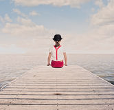 Little girl on a wharf Stock Image