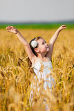 Little girl among wheat ears Stock Photography