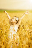 Little girl among wheat ears Royalty Free Stock Photography
