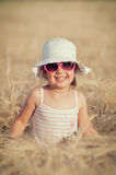 Little girl in wheat field Royalty Free Stock Image
