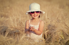 Little girl in wheat field Royalty Free Stock Photos