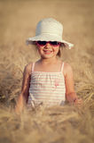 Little girl in wheat field Stock Photo