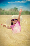 Little girl in wheat field Royalty Free Stock Images