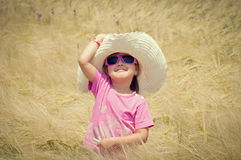 Little girl in wheat field Stock Photos