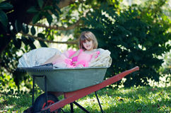 Little girl in wheelbarrow Royalty Free Stock Images