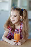 Little girl, which sits on table Royalty Free Stock Image