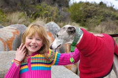 Little girl with whippet companion Stock Images