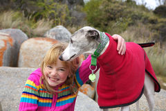 Little girl with whippet at park Royalty Free Stock Photos