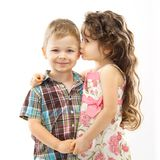 Little girl whispering something to boy. And holding his hands. Love concept. Isolated on white background Royalty Free Stock Photos