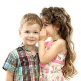 Little girl whispering something to boy Stock Image
