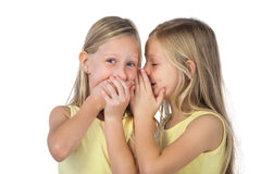 Little girl whispering to her sister Stock Photo