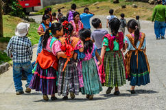 Little Girl Whispers in a Friends Ear - Guatemala Stock Photography