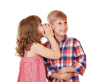 Little girl whispers a secret Royalty Free Stock Photo