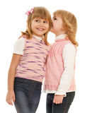 Little girl whispers something her friend Royalty Free Stock Image