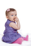The little girl on a white background. Cute little child eating sweet cookie stock images