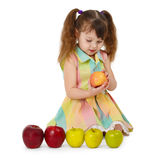 Little girl on white background with apples Royalty Free Stock Photos