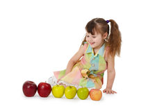 Little girl on white background with apples Royalty Free Stock Photo