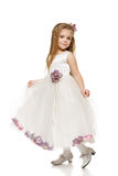 Little girl in white ball dress Stock Photos