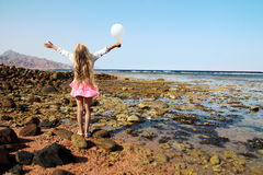 Little girl with white balloon stock photo