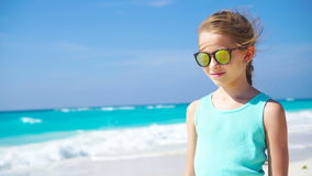 Little girl on the white beach. Portrait of adorable kid on her summer tropical holidays stock video