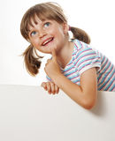 Little girl with white blank. With empty space for text or picture Royalty Free Stock Photography