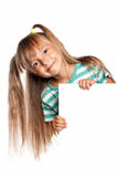 Little girl with white blank. Portrait of happy little girl with white blank isolated on white background Royalty Free Stock Image