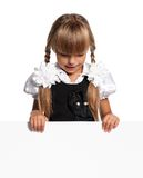 Little girl with white blank. Portrait of happy little girl with white blank isolated on white background Stock Photo
