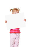 Little girl with white board Royalty Free Stock Photos