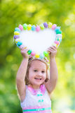 Little girl with white board for Easter greetings Stock Images