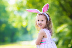 Little girl with white board for Easter greetings Royalty Free Stock Image