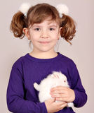 Little girl with white bunny Royalty Free Stock Photo