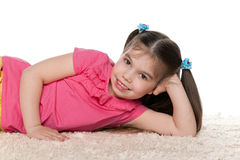 Little girl on the white carpet Royalty Free Stock Images