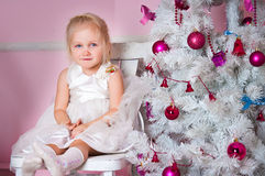 The girl at the Christmas fir-tree with gifts Stock Photography