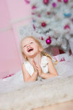 The girl at the Christmas fir-tree with gifts Royalty Free Stock Photo