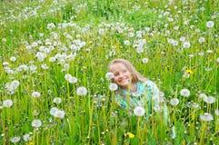 Little girl in white dandelion Stock Images