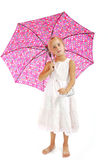 Little girl in white dress. With pink umbrella Stock Image