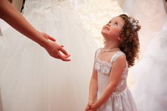 Little girl in white dress. Royalty Free Stock Images