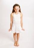 Little girl in white dress Stock Image