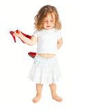 Little girl in white dress with big red shoes. Isolated on white background Royalty Free Stock Photos