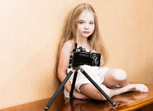 Little girl in white dress with camera. Little girl in white dress with vintage camera Stock Photo
