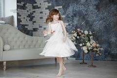 Little girl in white dress are dansing and moving stock image