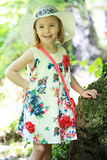 Little girl in white dress forest background Royalty Free Stock Images