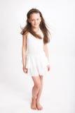 Little girl in white dress Stock Images