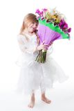 Little girl in white dress hold bouquet of flowers Stock Photos